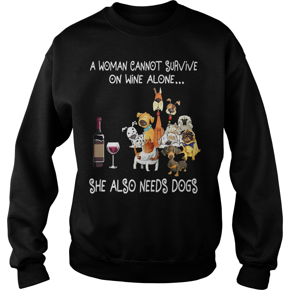 A woman cannot survive on wine alone she also needs dogs Sweater